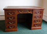 Lot 151: 19th century mahogany inlaid pedestal desk with satinwood crossbanding, leather inset, with writing slide to each side  est. €1000/1500