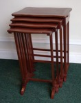 Lot 19: Early 20th century nest of four mahogany and brass tables est. €500/800