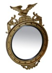 Lot 20: Early 20th century gilt convex circular mirror, surmounted by eagle  est. €300/500