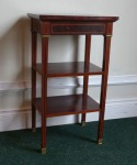 Lot 21: Early 20th century three tier mahogany what-not, with crossbanding to top est. €400/600