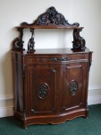 Lot 56: Exceptionally fine two-door Irish rosewood 19th century side cabinet with carved panels and shelf to back  est. €1500/2500