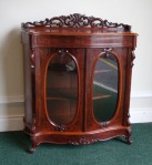 Lot 79: Victorian mahogany two-door chiffonier side cabinet, with oval doors and fretwork carving to back, circa 1890 est. €800/1200