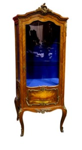 A gilded and ormolu mounted bombe shaped 19th century Vitrine