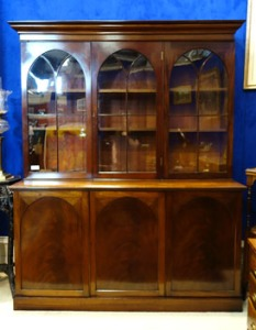 Lot 37 - Irish, three door, mahogany Library Bookcase, with arched Astragal Glazed Doors, over three door Cupboard beneath, 5ft x 6ft - Hammer Price: €6300