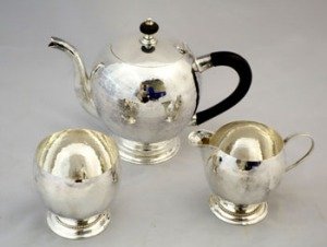 An Irish Silver Tea Set, Consisting of Pot, Sugar Bowl and Jug, each Decorated with a hammered effect, 20th Century, with Maker's Mark W.E., William Egan & Sons est 600-800 Eur for Auction at Hegartys on Tues 18th October