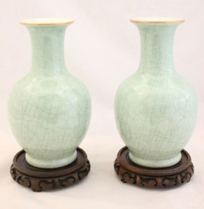 A PAIR OF 19TH CENTURY GREEN CELADON CRACKLE VASES, on carved wooden bases for Auction at Hegartys on Tues 15th Nov at 7pm, est 900-1200 Eur