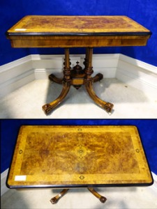 "A FINE VICTORIAN BURR WALNUT & MARQUETRY INLAID FOLD OVER CARD TABLE, with a rounded rectangular shape which has ebonised edge, raised on a birdcage support of 4 turned and fluted columns, on splayed feet terminating on castors, 35""x19""x28"" Approx WxDxH - Price Realised €2050"