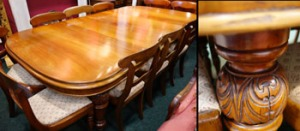 A DINING ROOM TABLE, WITH EXTENDABLE LEAVES, raised on carved & fluted legs, terminating with castors. Price Realised €2350