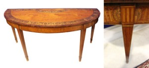 "A LARGE IRISH SATINWOOD AND MARQUETRY INLAID, DEMI LUNE, SIDE TABLE, by William Moore of Dublin, the semi elliptical top whose border is decorated with oval floral panels, and a large demi-medallion floral centre panel, with inlaid satinwood, sycamore and tulipwood, raised on tapering legs with an inlaid fluted freize, 64""x32""x25"" approxWilliam Moore learned his trade in London working under the renowned firm of Mayhew and Ince, Moore set up in Dublin 1785 - 1815 where he had workshops in Abbey Street and then Chapel Street, among some of his notable clients was the third Duke of Portland, Viceroy of Ireland in 1782 - Price Realised €18600."