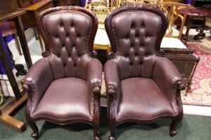 Lot 239: A PAIR OF CONTEMPORARY VICTORIAN STYLE BUTTON BACKED ARMCHAIRS, in very good condition, with carved floral decoration to the frame