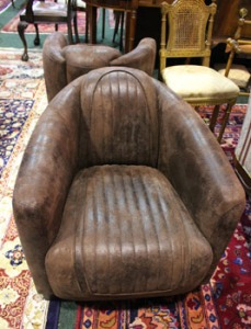 Lot 36: A PAIR OF AVIATION ARMCHAIRS, with soft leather covering