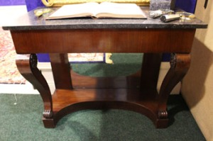Lot 58: A 19th CENTURY MAHOGANY CONSOLE or HALL TABLE, SHAPED PLATFORM BASE, and mirrored back, and a marble top