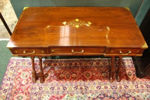 "LOT 38: A LARGE BRASS INLAID SOFA/SIDE TABLE, raised on turned cross legs, 48""x30""x24"" (LxHxW)"