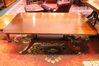 A COFFEE TABLE, horizontal fluted rim, raised on 4 turned suppor