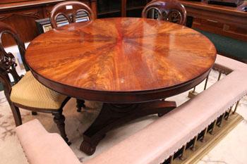 AN IRISH REGENCY MAHOGANY CENTRE or LIBRARY TABLE, with Sunburst